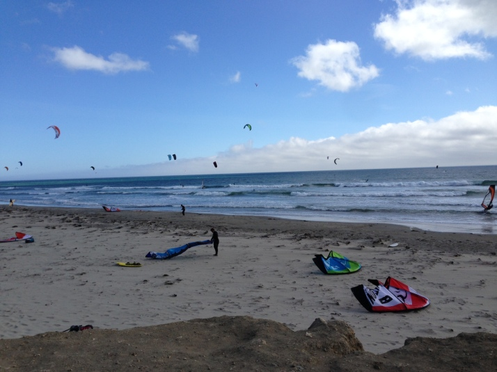 Waddell filled with kiteboarders and windsurfers